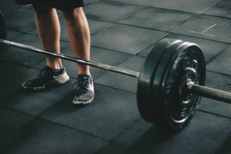 barbell in home garage gym